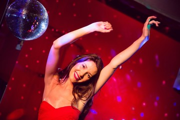 Pretty brunette dancing and smiling