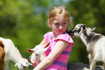 Girl and Baby Goats