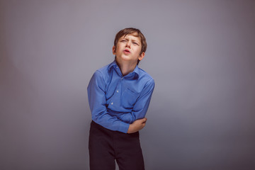 teenager boy abdominal pain on gray  background