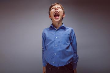 teenager boy brown hair European appearance screams mouth wide o