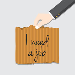 Hand holding cardboard paper with I need job message