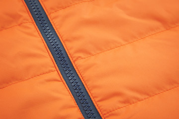 Orange waterproof textile with ziplock background