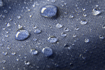 Blue waterproof membrane textile background with drops
