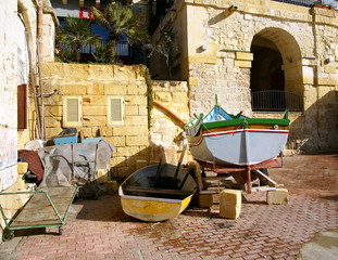 Isolated rustic corner with fishing boats in break