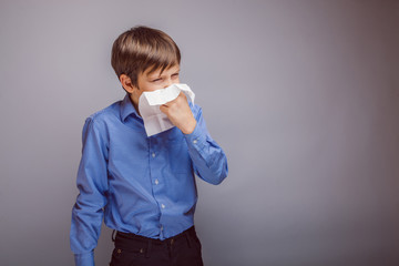teenager boy of 10 years European appearance sick sneezing in