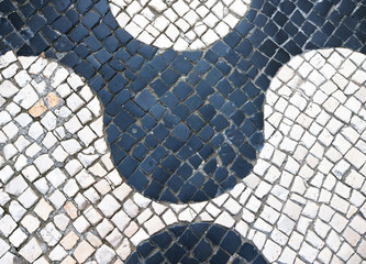 "Typical Portuguese black and white stone mosaic ""calcada"" paveme"