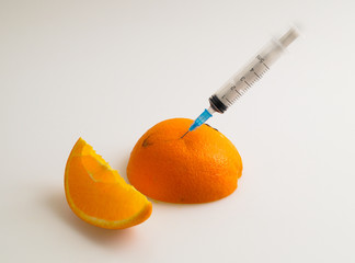orange with syringe