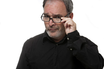 Mature man with glasses looking at camera