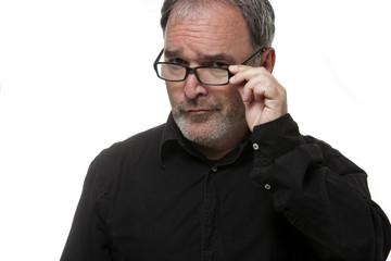 Mature man with glasses looking at camera