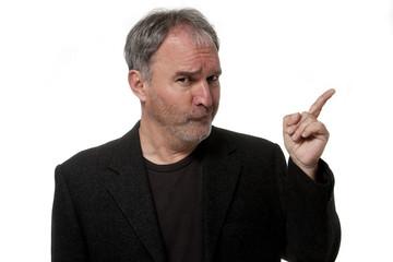Mature man makes grimace and pointing his finger