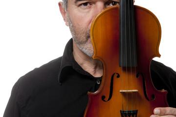 Violinist ripe black dress hugs a violin on white background
