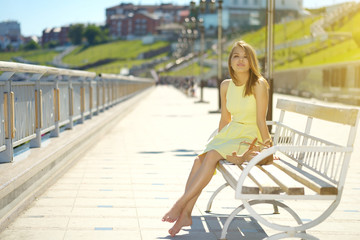 Attractive girl in a yellow dress
