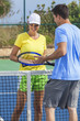 Man Woman Couple Playing Tennis or Lesson