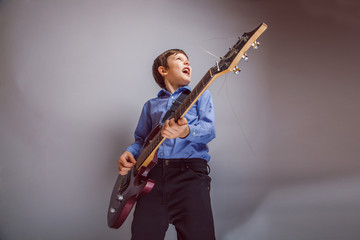 boy adolescence European appearance sings plays guitar