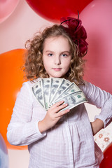 Teen girl holding a fan in her hand dollars.