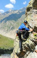 man climbing on rock