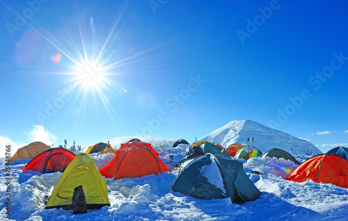 Tents of climbers high in the mountains - 75948766