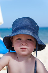 Baby boy with sun hut at the sea beach