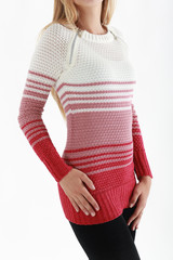 Young slim blond woman's torso in tight striped sweater isolated