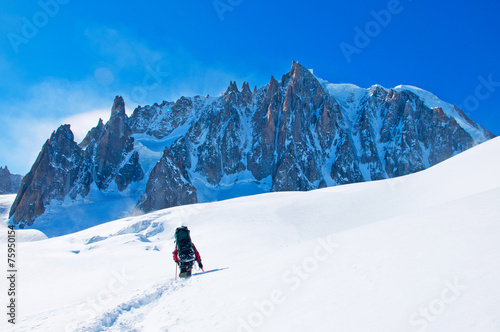 Extreme Sport. Lone hikers in winter mountains - 75950154