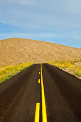 Desert road in Death Valley National Park, California USA