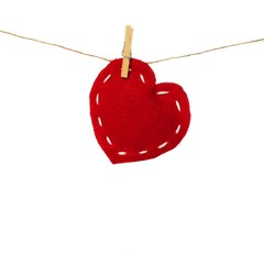 Valentines Day cloth heart on clothesline isolated on white