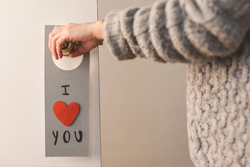 Valentine's day lovely message hanging on a door.