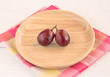 Red grapes in wooden platel