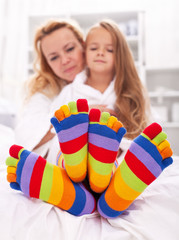 Woman and little girl wearing funny socks