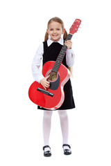 Happy girl with elegant outfit and guitar