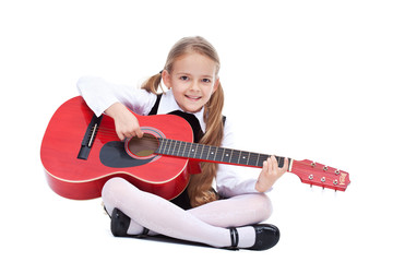 Happy little girl with guitar