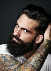 Portrait of a tattooed bearded man