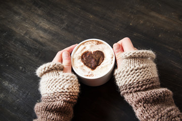 Hands Holding Heart Shape Cappuccino