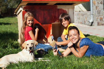 Happy family building a doghouse together