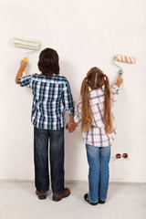 Kids painting their room together
