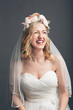 Charming vivacious young bride laughing