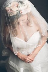 Demure bride with her veil over her face
