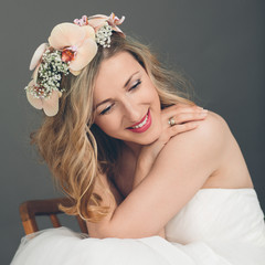 Attractive bride with a tender smile of happiness
