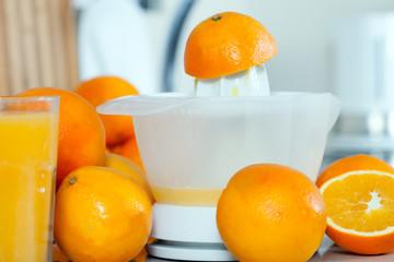 fresh oranges and juicer