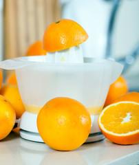 few oranges near the hand juicer