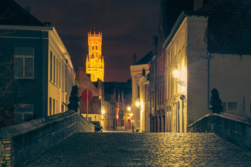 Cityscape with a picturesque night street and tower Belfort in