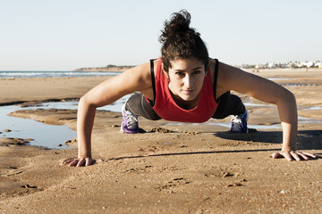 Strong woman doing pushups