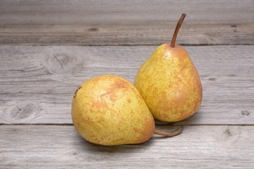Golden pear on wood table.