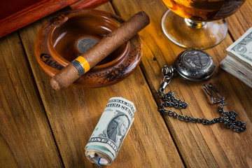 Relaxing cuban cigar after hard day, with glass of Rum