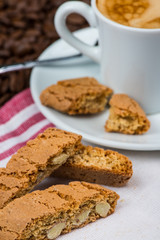 almond biscuits with cup of coffee