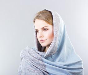 beautiful blonde in a blue shawl.