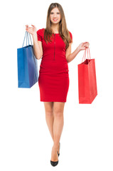 Elegant woman with shopping bags isolated on white