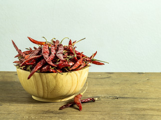 Red chili peppers in wooden cup