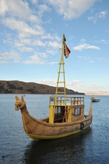 Reed boat to us Mountain Lake Titicaca