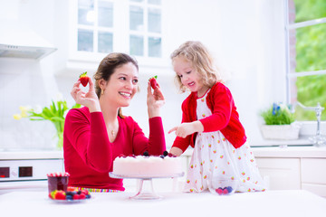 Mother and daughter baking strawberry pie